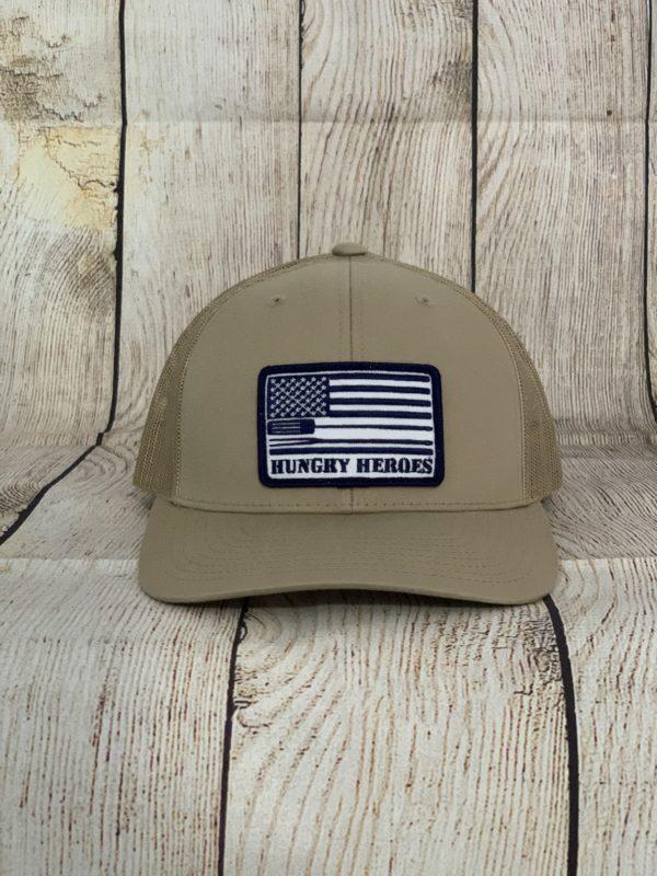 tan and black bbq hat